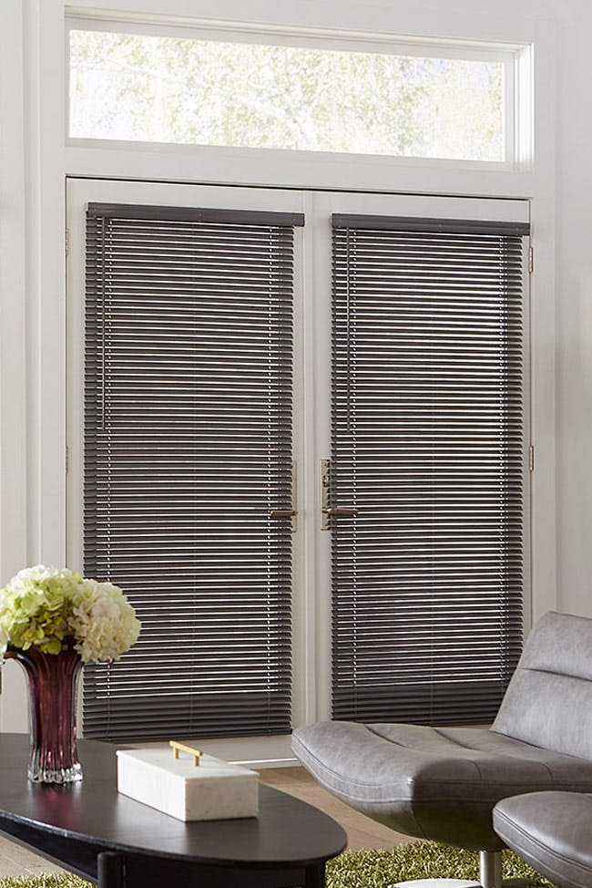 Living Room French Doors with gray mini blinds installed.