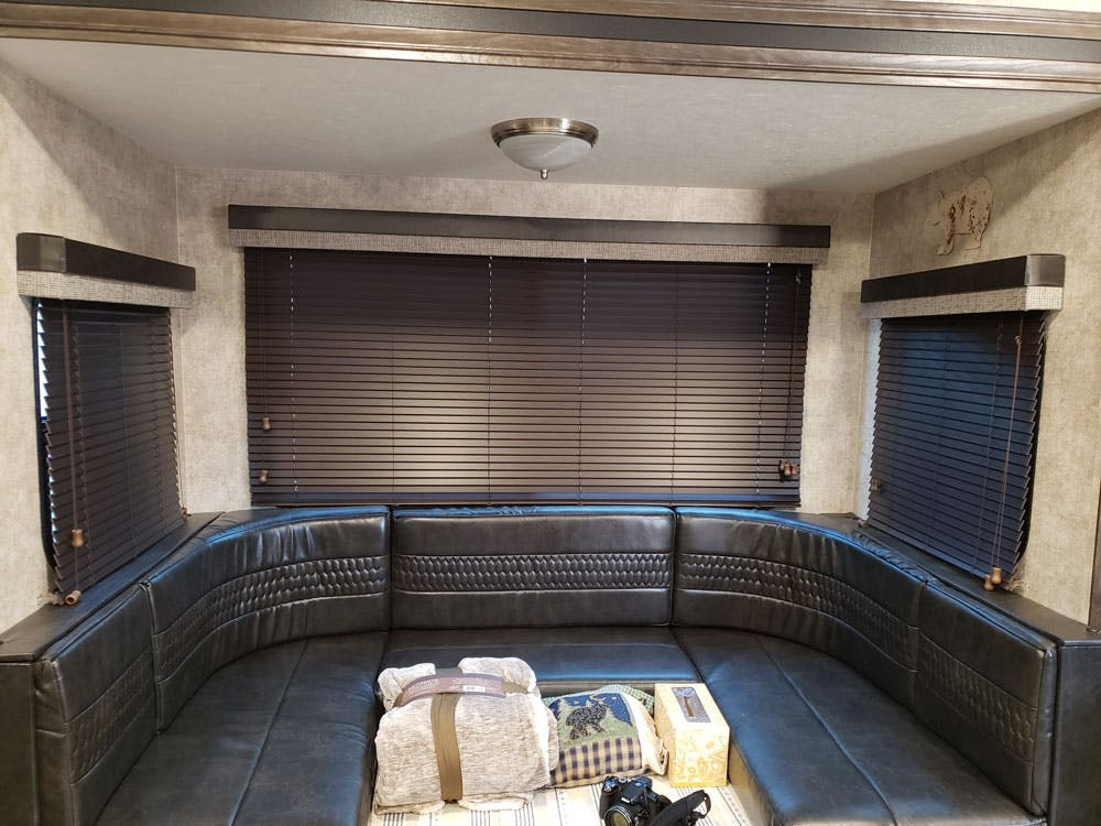 rv built in couch with mini blinds on window