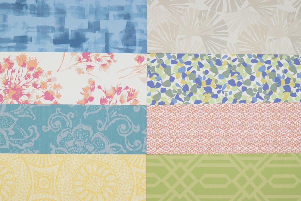 Image showing the variety of patterns and colors for the Economy Blackout, Light Filtering and Solar Shades. Colors shown top left to bottom right: Brushstrokes Denim, Ginko Sienna, Cottonwood Spring, Petals Spring Mix, Courtyard Teal, Terra Nova Bloom, Taos Sunflower and Deco Aloe.
