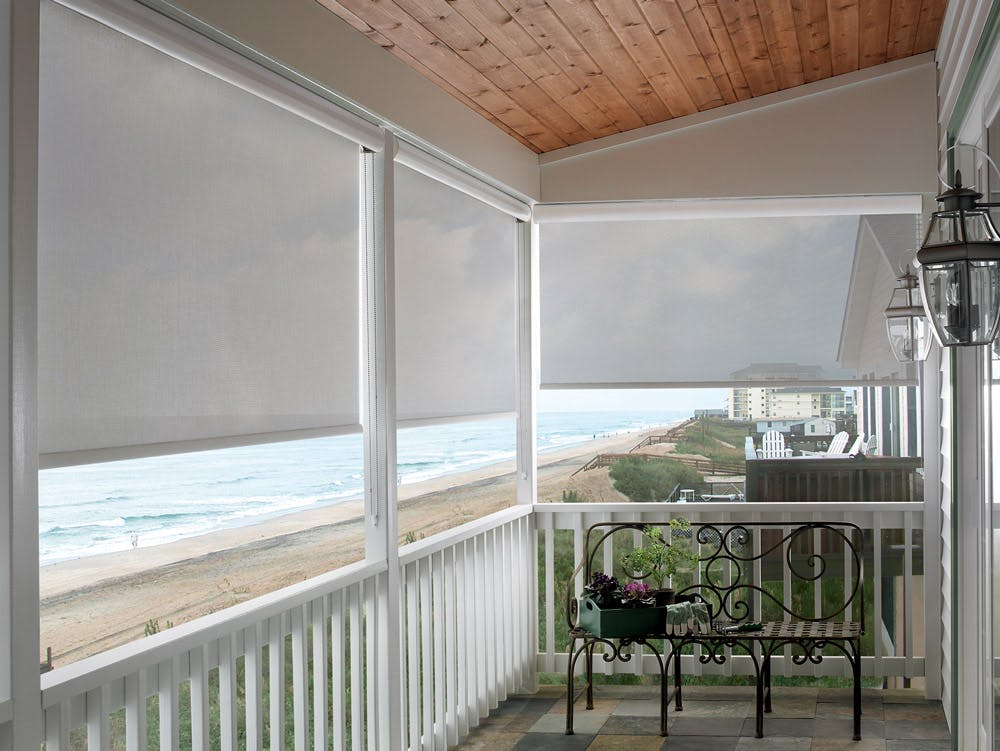 beach house balcony withsheer exterior shades