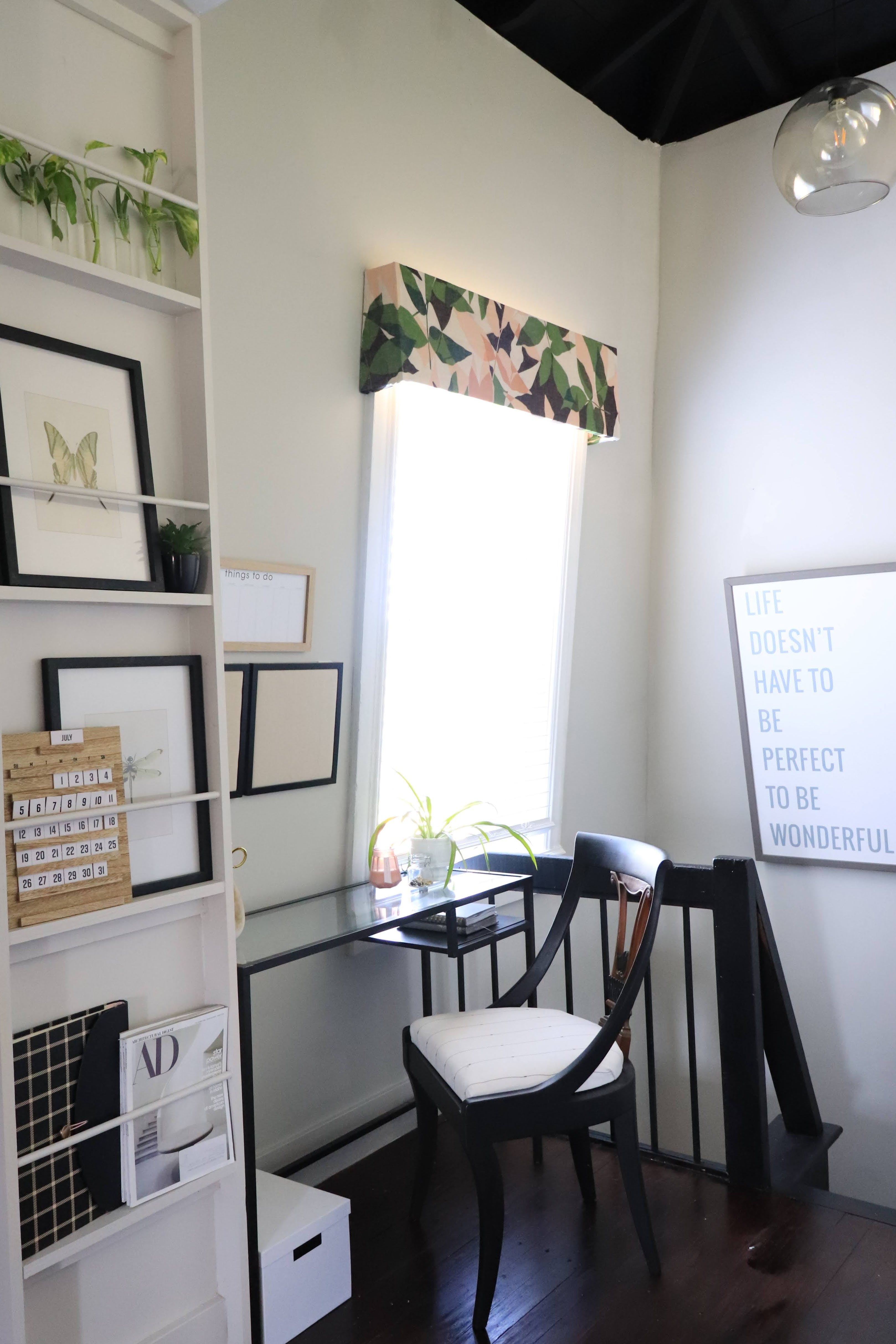 small desk workspace at top of stairs in loft