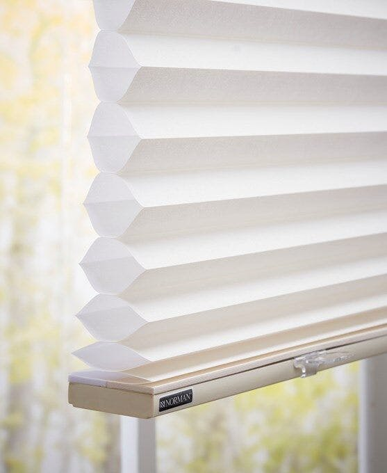Side view a cellular or honeycomb shade showing the insulating air pockets.