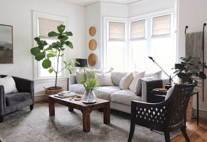 Living room with white walls and linen roman shades