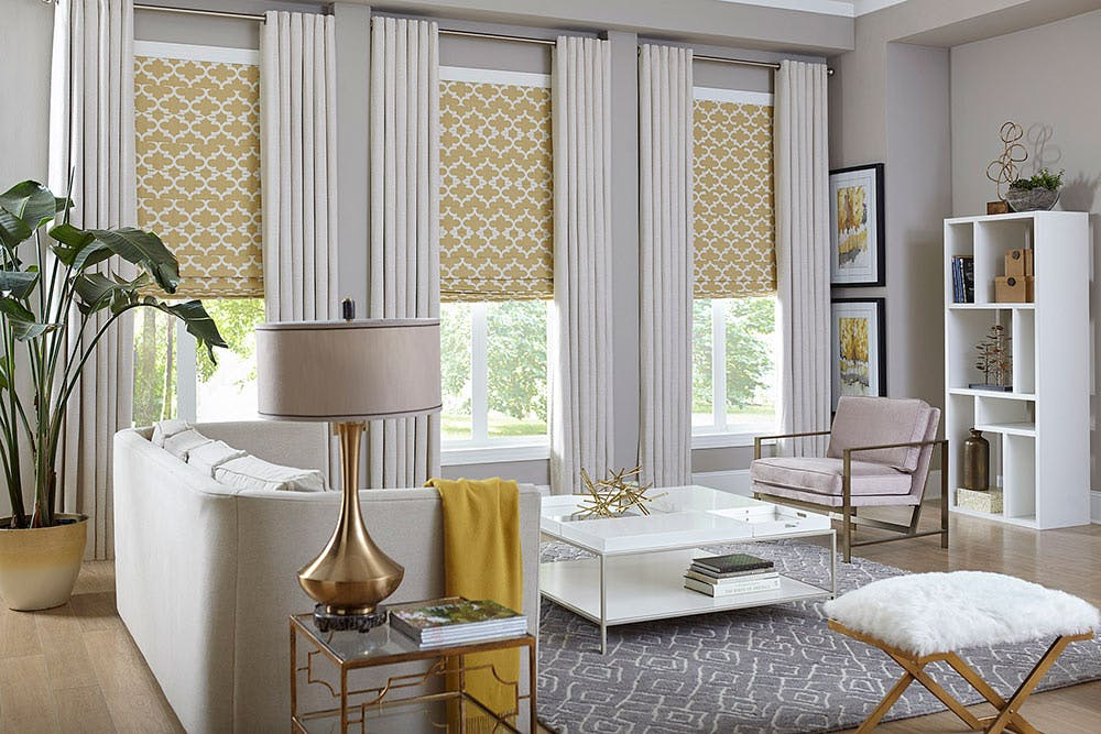 contemporary living room with yellow roman shades