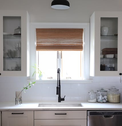kitcen window behind sink with bamboo window treatments