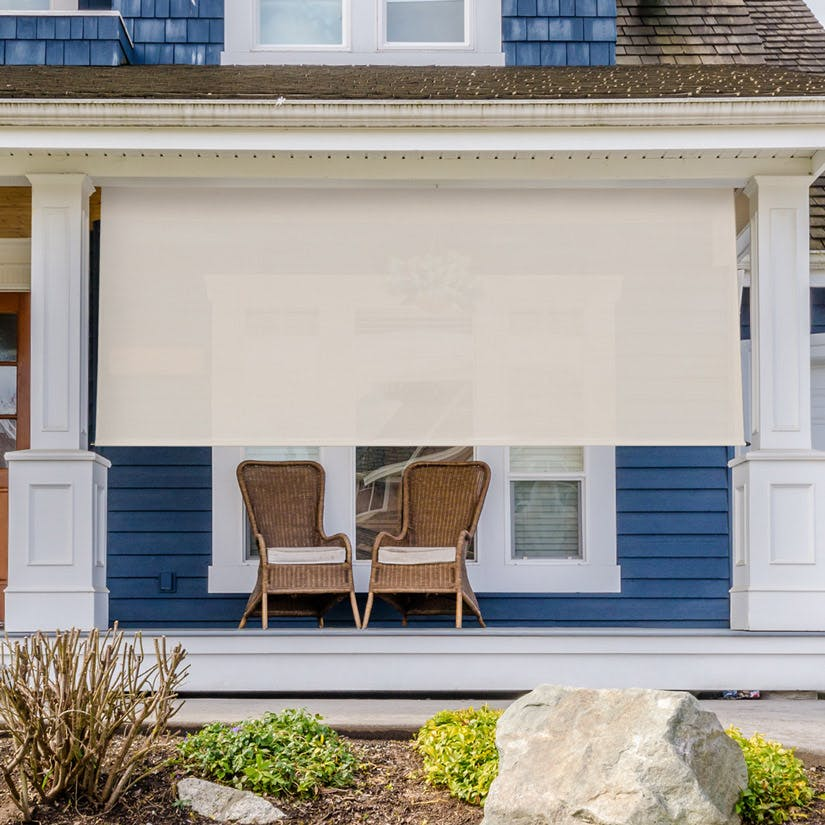 front porch with beige outdoor shade to block sun