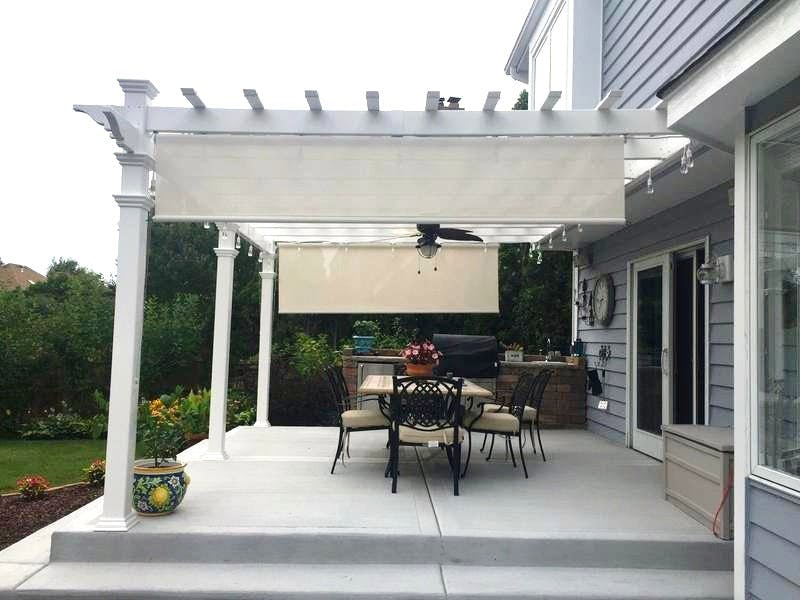 pergola off house with roll down exterior shades