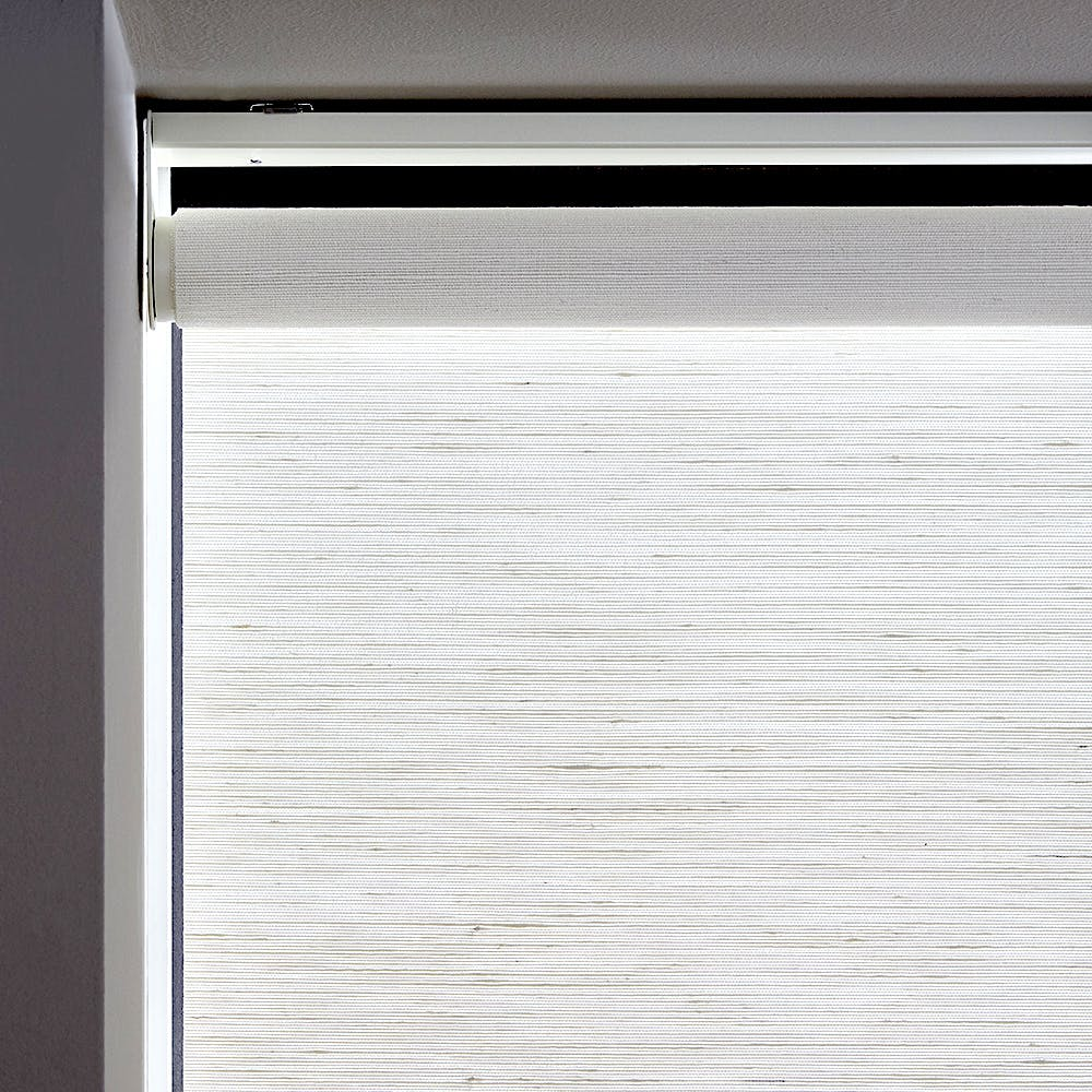 a close up of a roller shade showing the light gap on an inside mount.