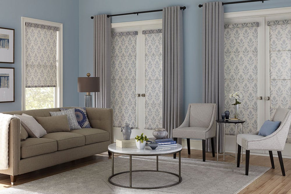 living room with roller shades on french doors