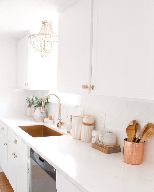 white kitchen with gold hardware and gold sink