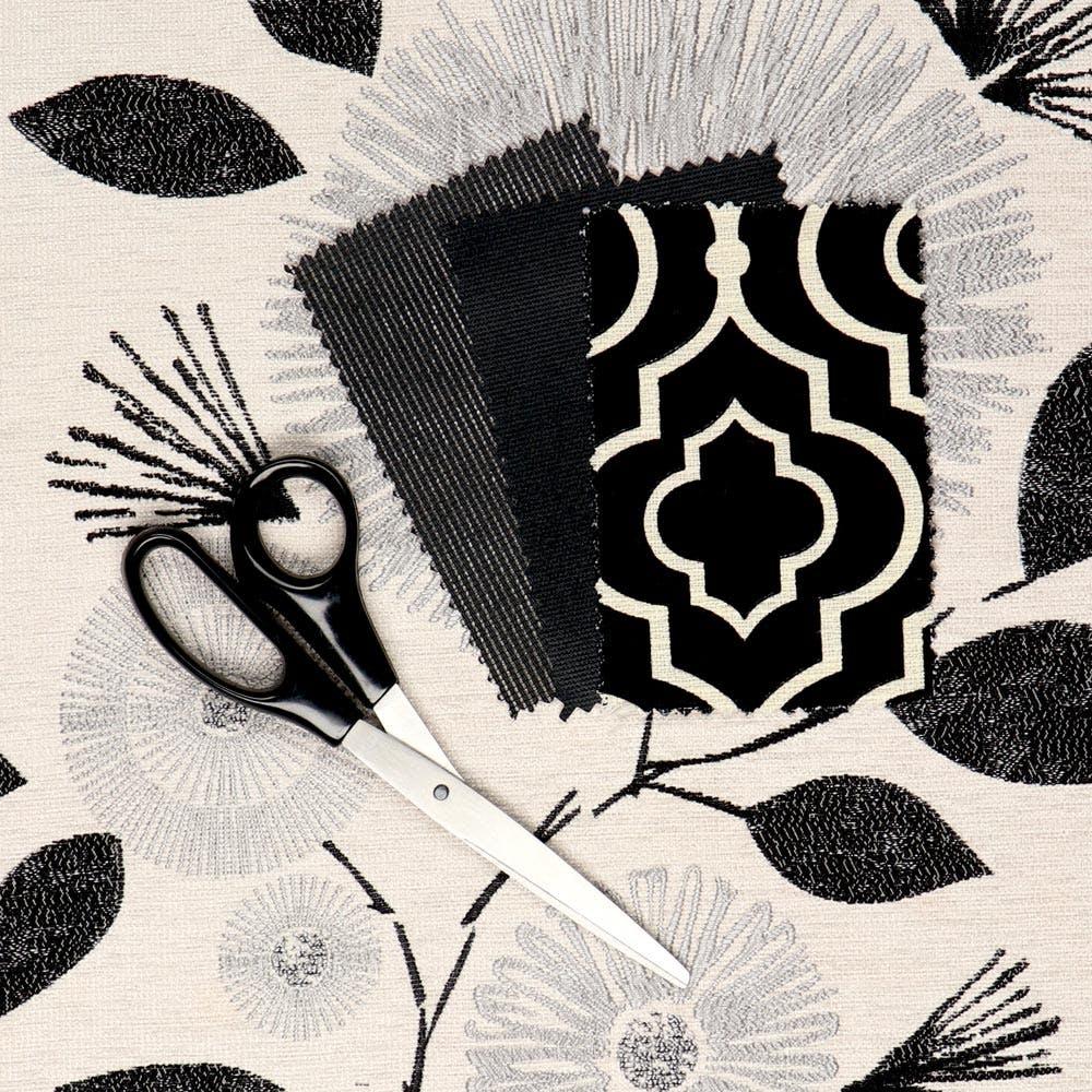 black roman shade swatches and black scissors.