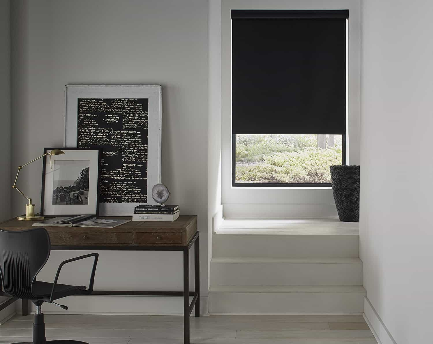 Sleek, modern roller shades in the hallway next to a home office.