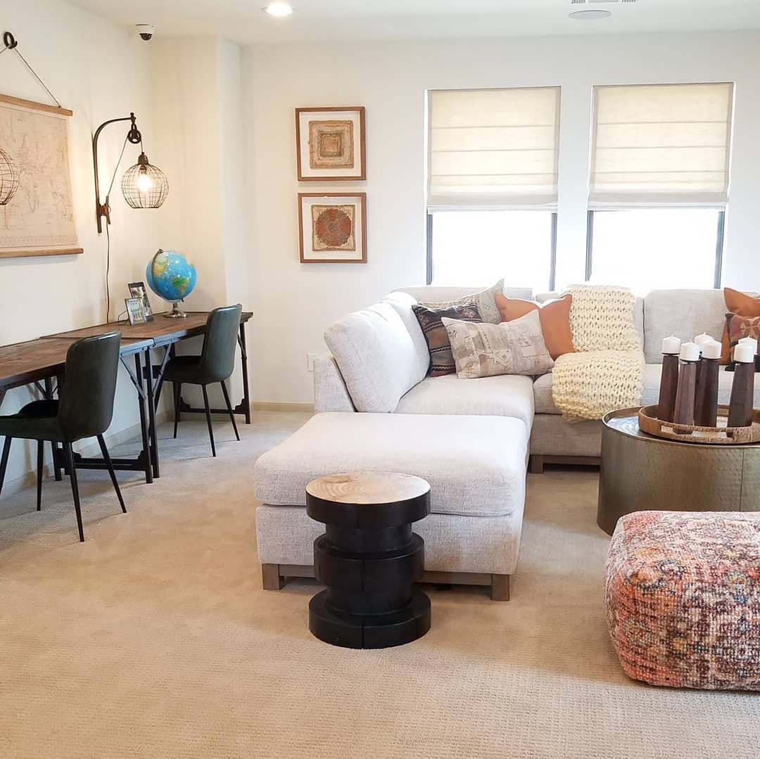 Neutral toned, open concept living room and workspace.