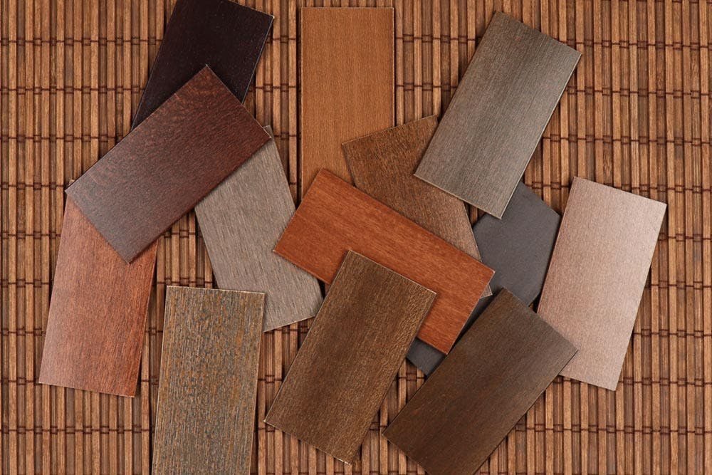 a pile of wood blinds samples.