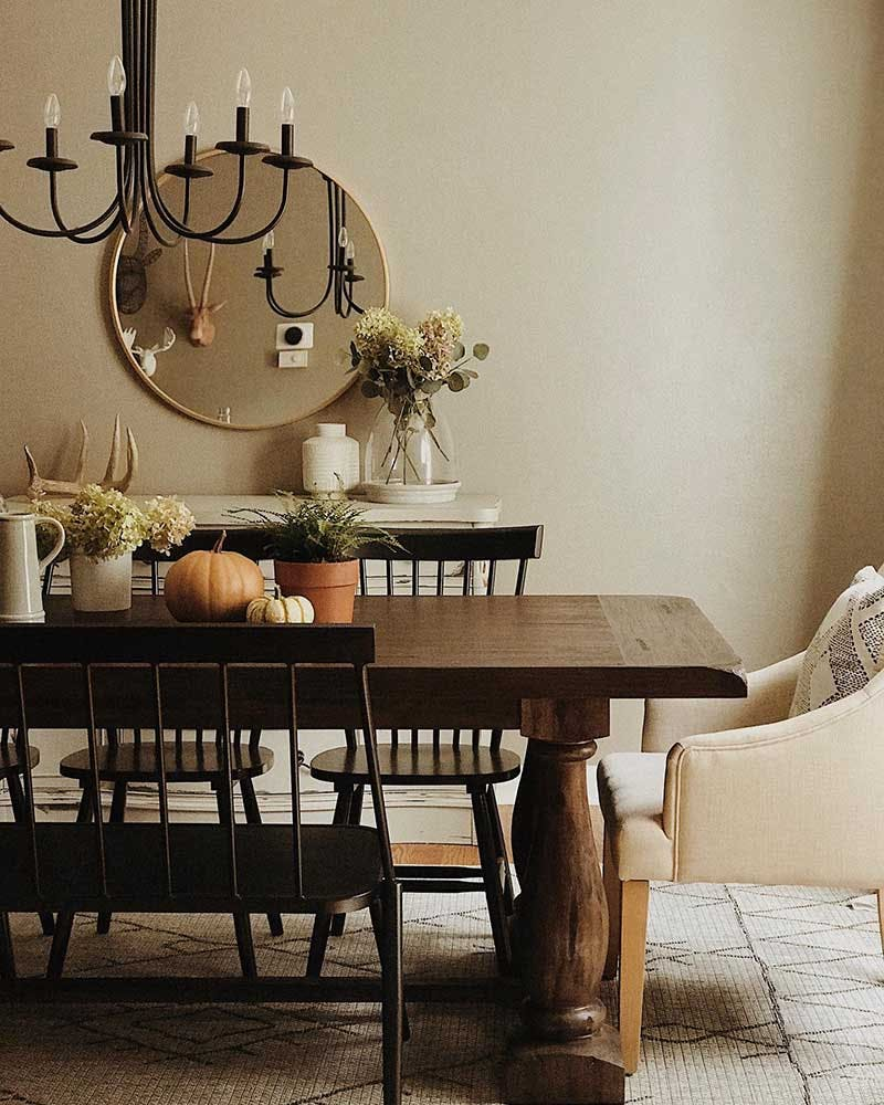 Rustic, heirloom dining room table with fall flowers and pumpkins.