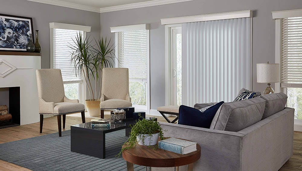 contemporary living room with sliding glass door covered with vertical blinds.
