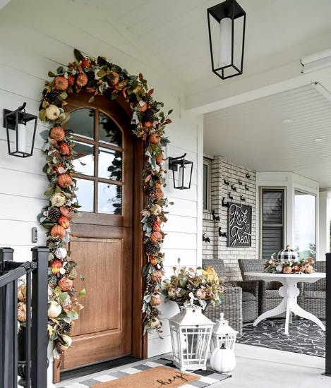 front door decorated with fall garland