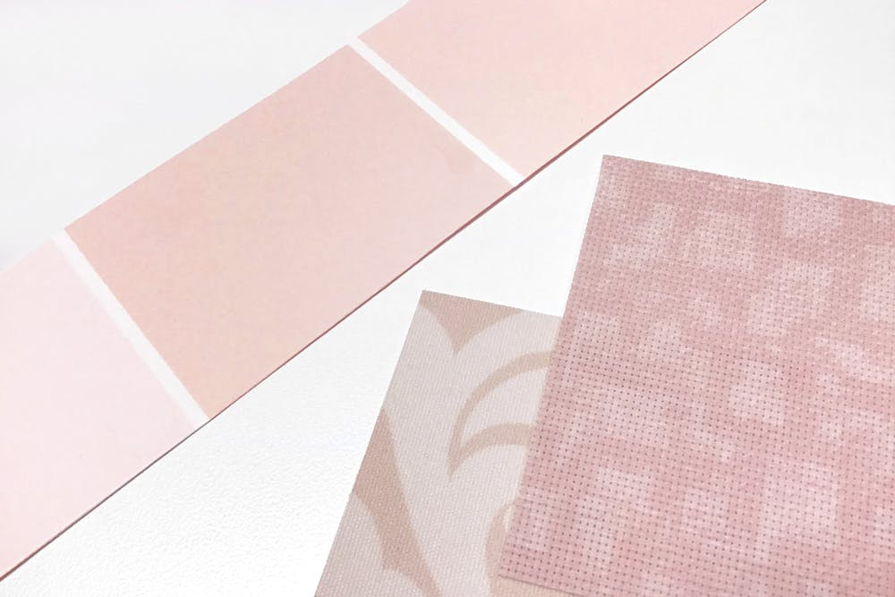 Pink paint swatches ext to pastel pink solar shade fabric samples