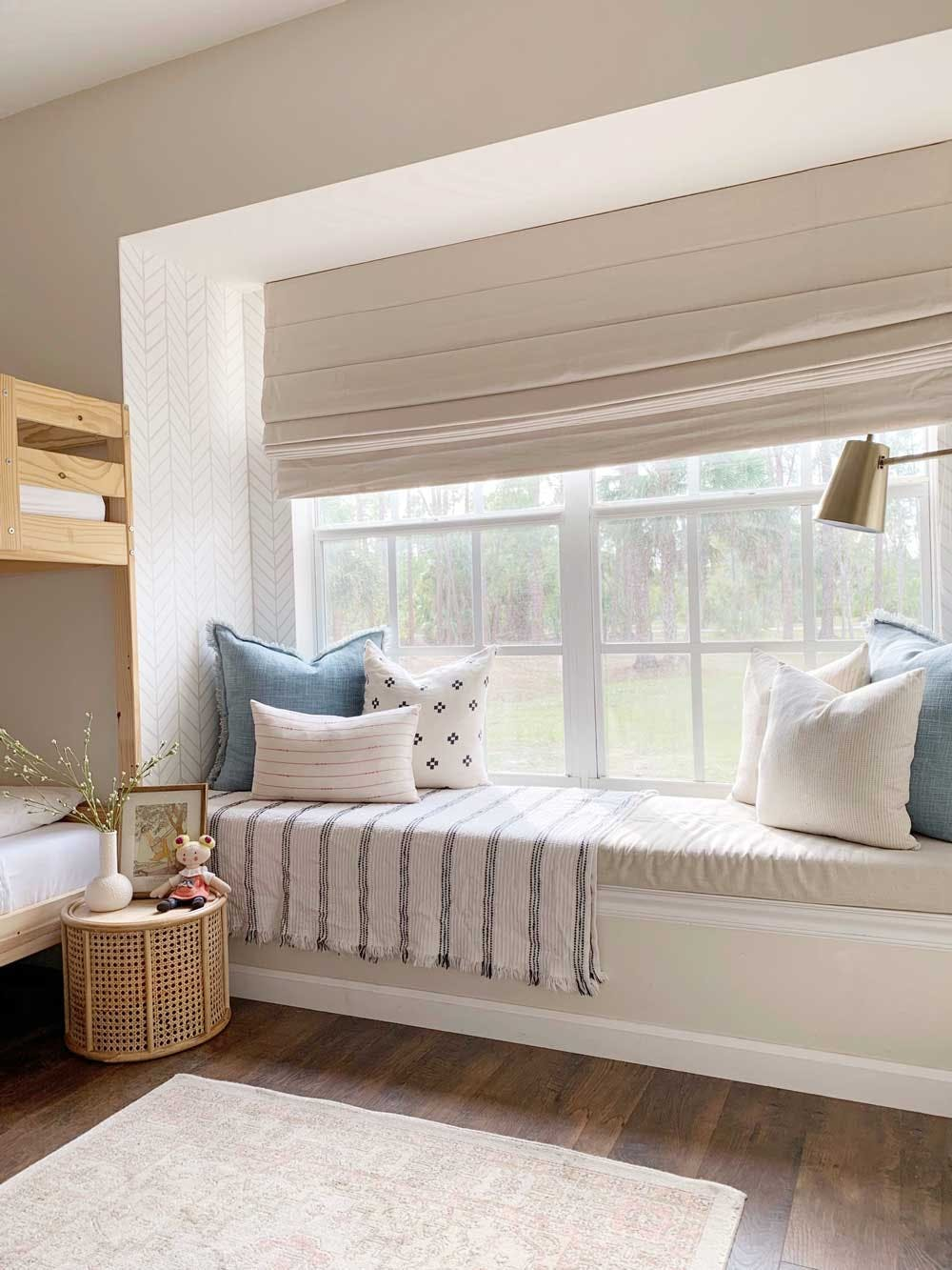 window seat with roman shade in bedroom