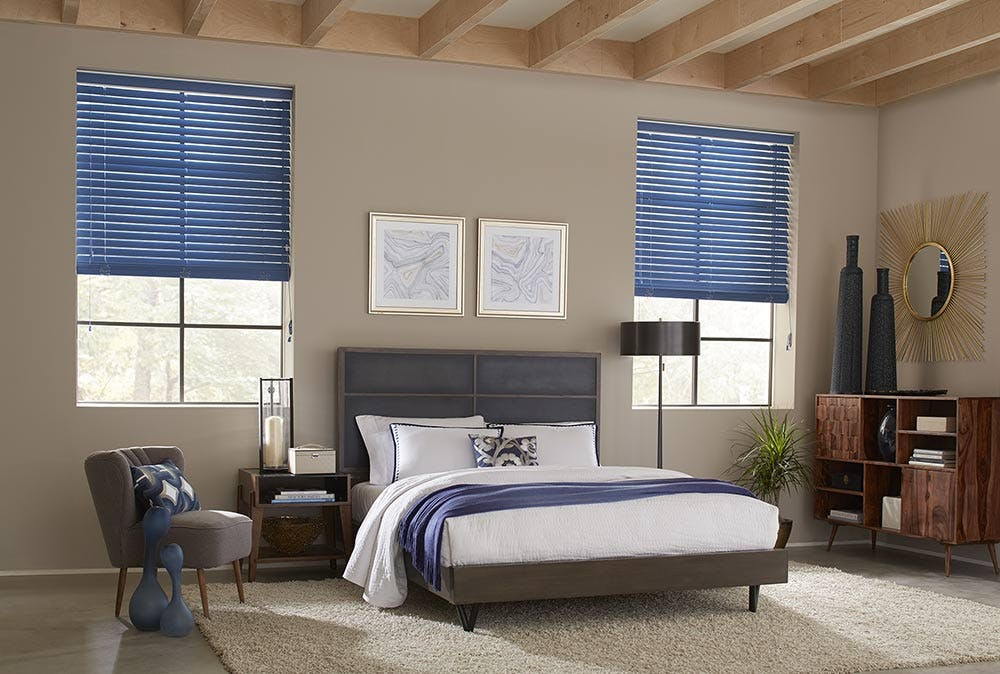 Blue fabric blinds in a contemporary bedroom.