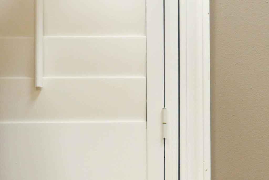 closeup of white interior shutters
