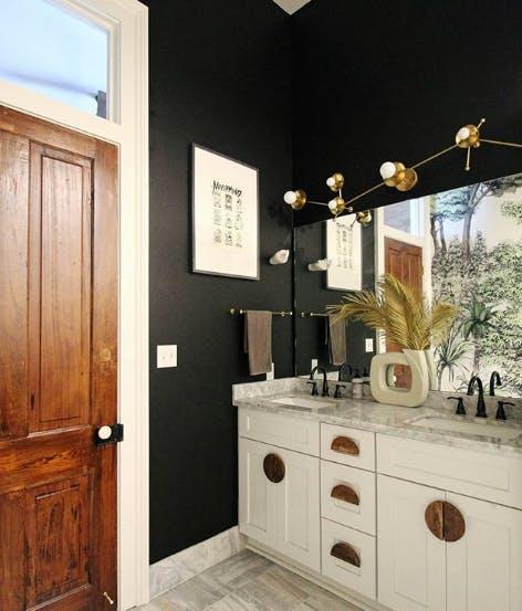 dark green bathroom with white cabinets