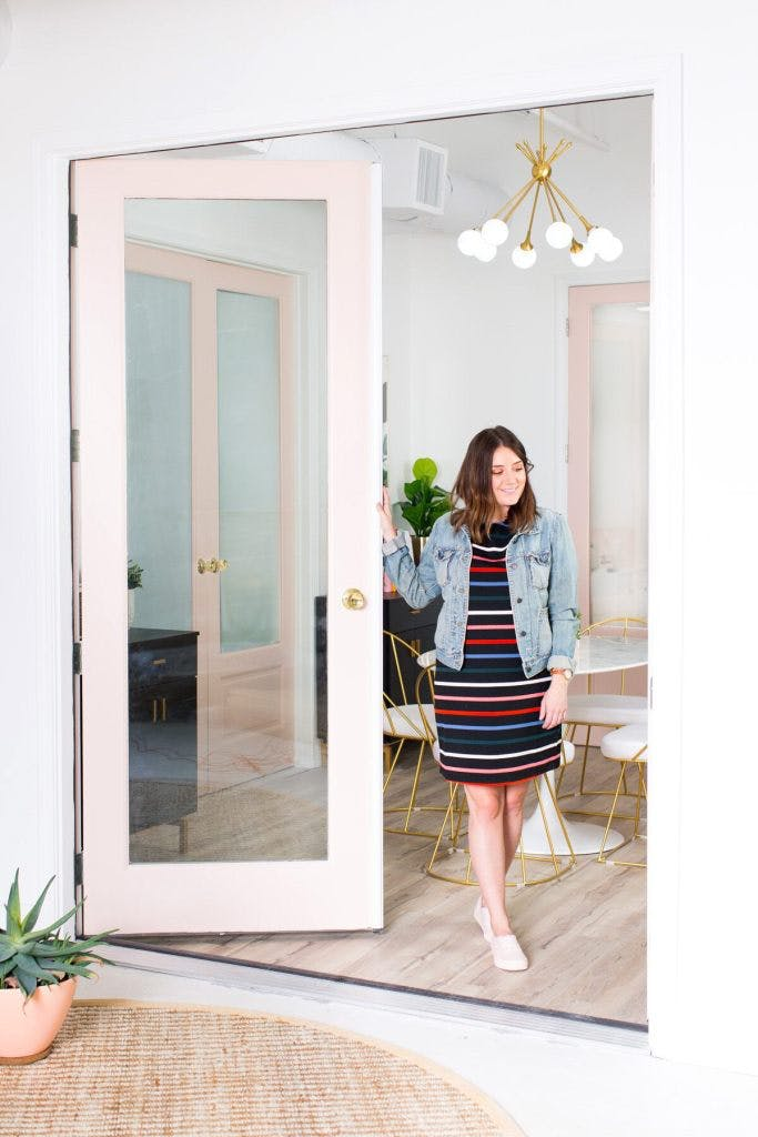 Ashley from Sugar and Cloth in studio meeting room with blush pink french doors