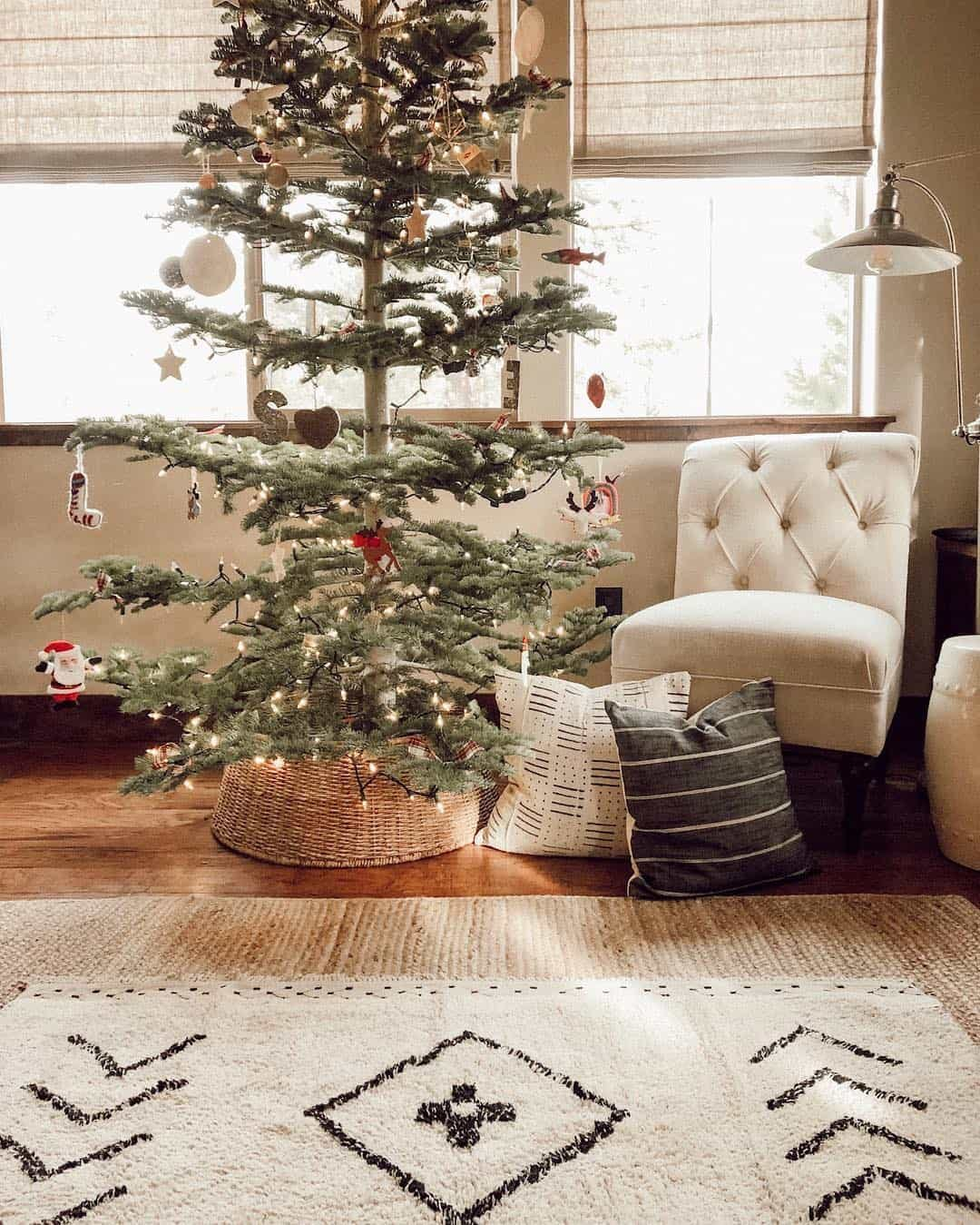 Living room with Christmas tree next to window.