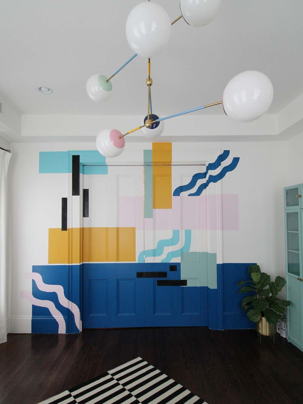 wall with colorful abstract mural in blue and yellow