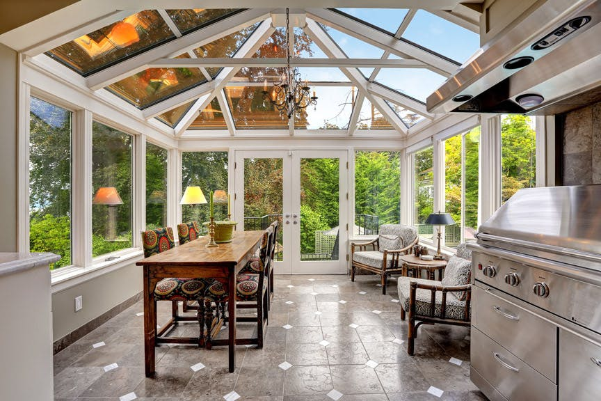 kitchen and dining room inside glass conservatory