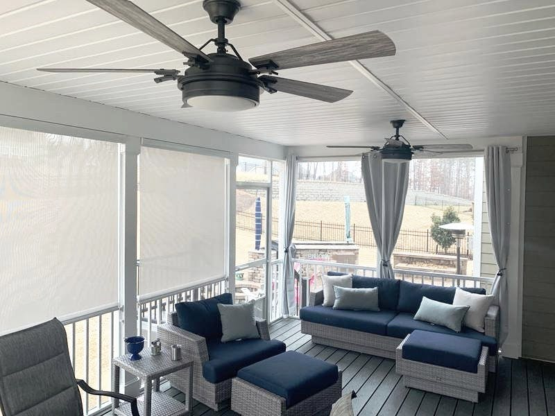 screened in porch with roll down sun shades