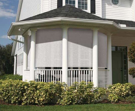 gazebo attached to house with solar shades