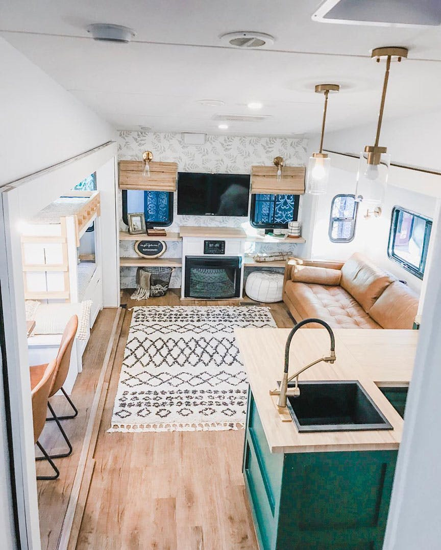 Renovated RV tiny home with woven wood shades