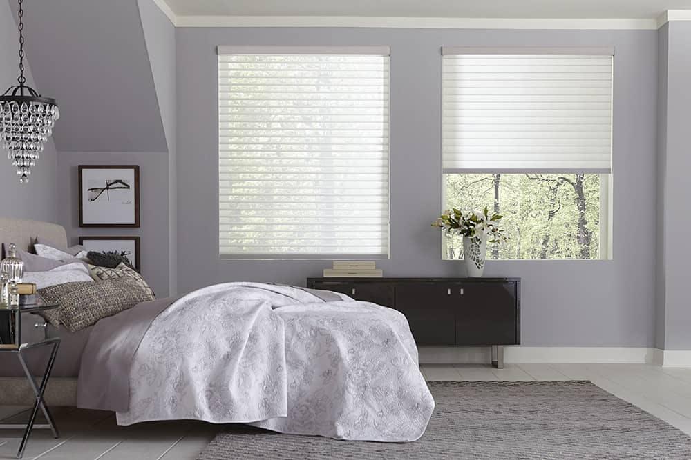 feminine bedroom with sheer window shades