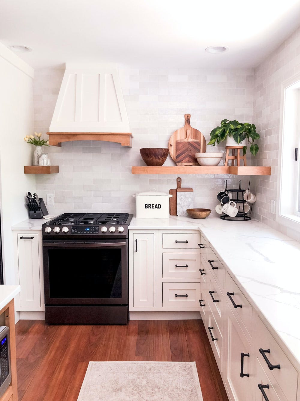 white fafmhouse kitchen with black appliances