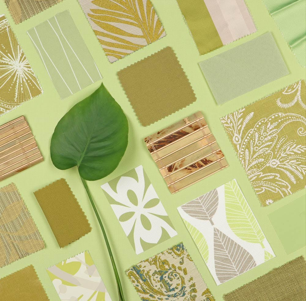 green, geometric themed blind and shade samples arrange in a grid pattern with a monstera leaf.