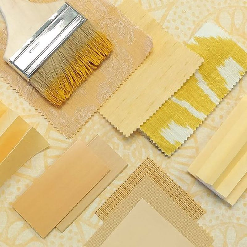 flatlay with layers of yellow swatches for blinds and shades.