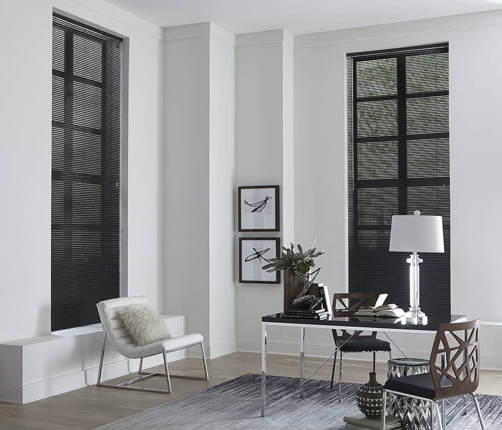 modern office with tall windows and black mini blinds