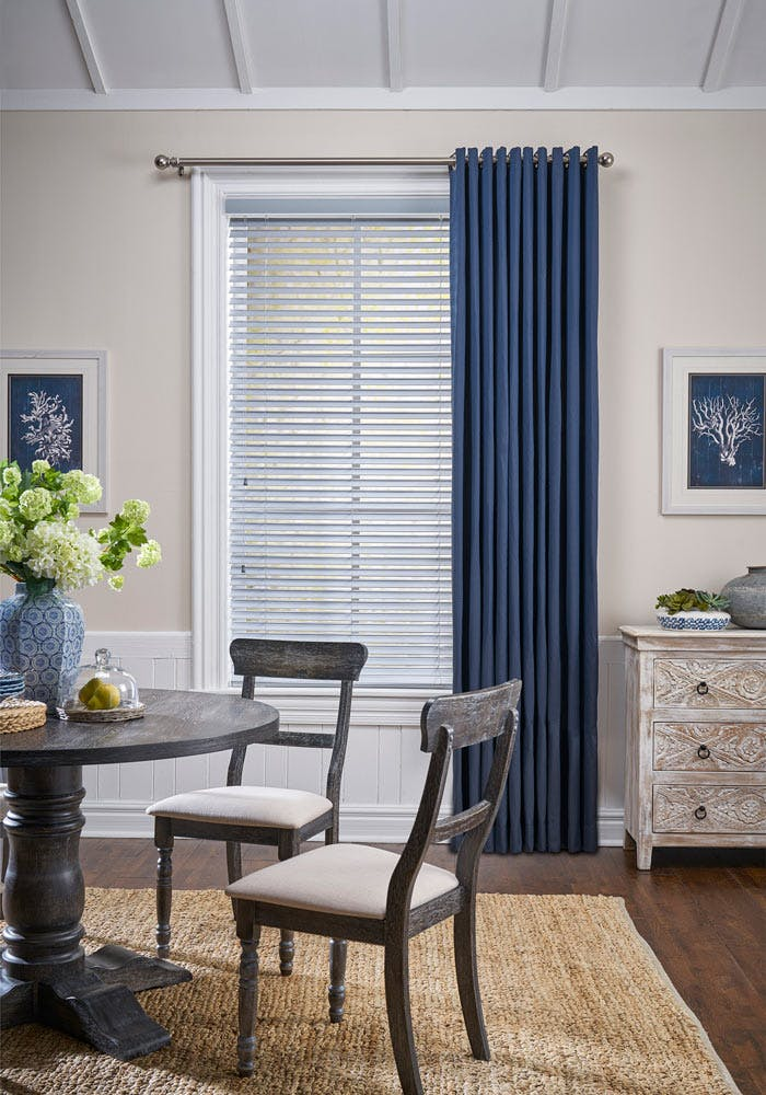 Blue draperies in a traditional dining room.