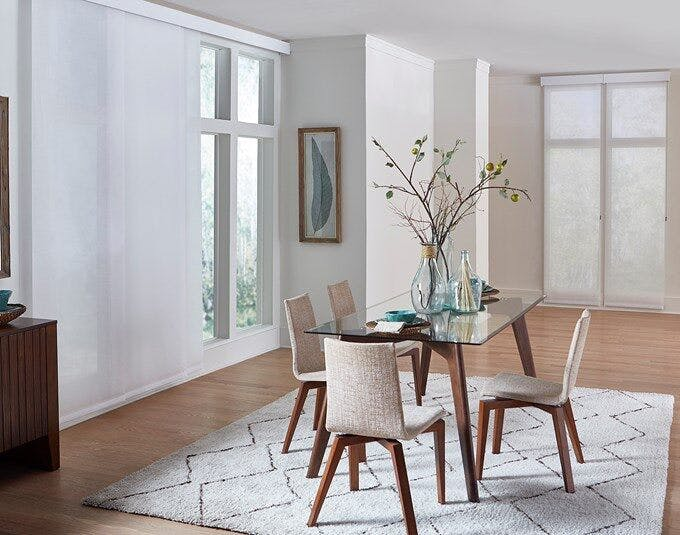 dining room with large windows and sliding panel shades