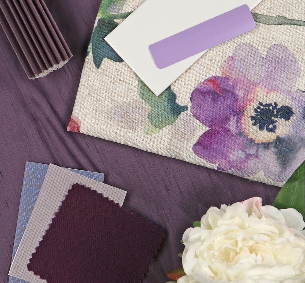 purple fabric swatches layered together in a flatlay.