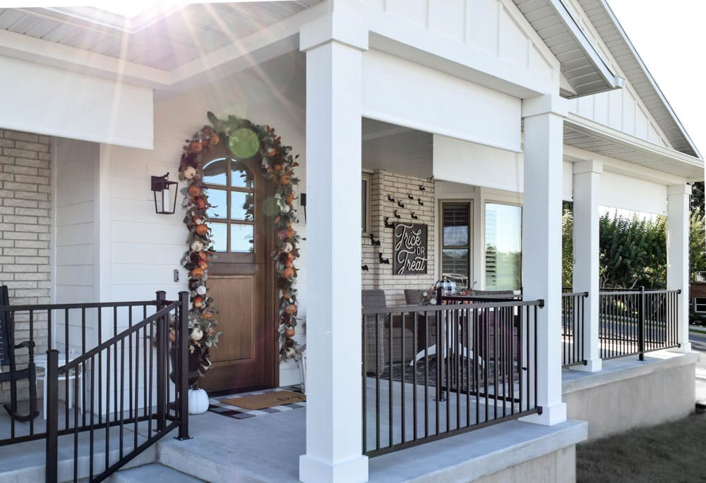 front porch with white sun shades