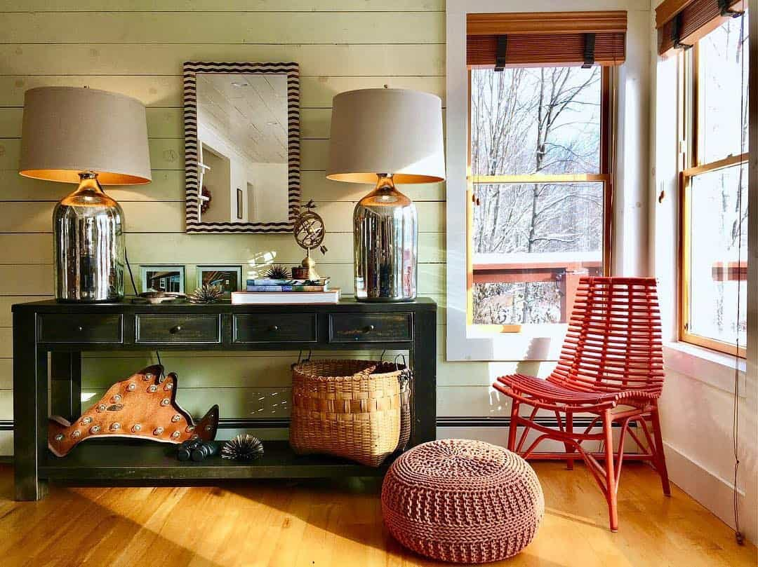 Rustic sunroom with light green shiplap walls and copper toned wood blinds in window.