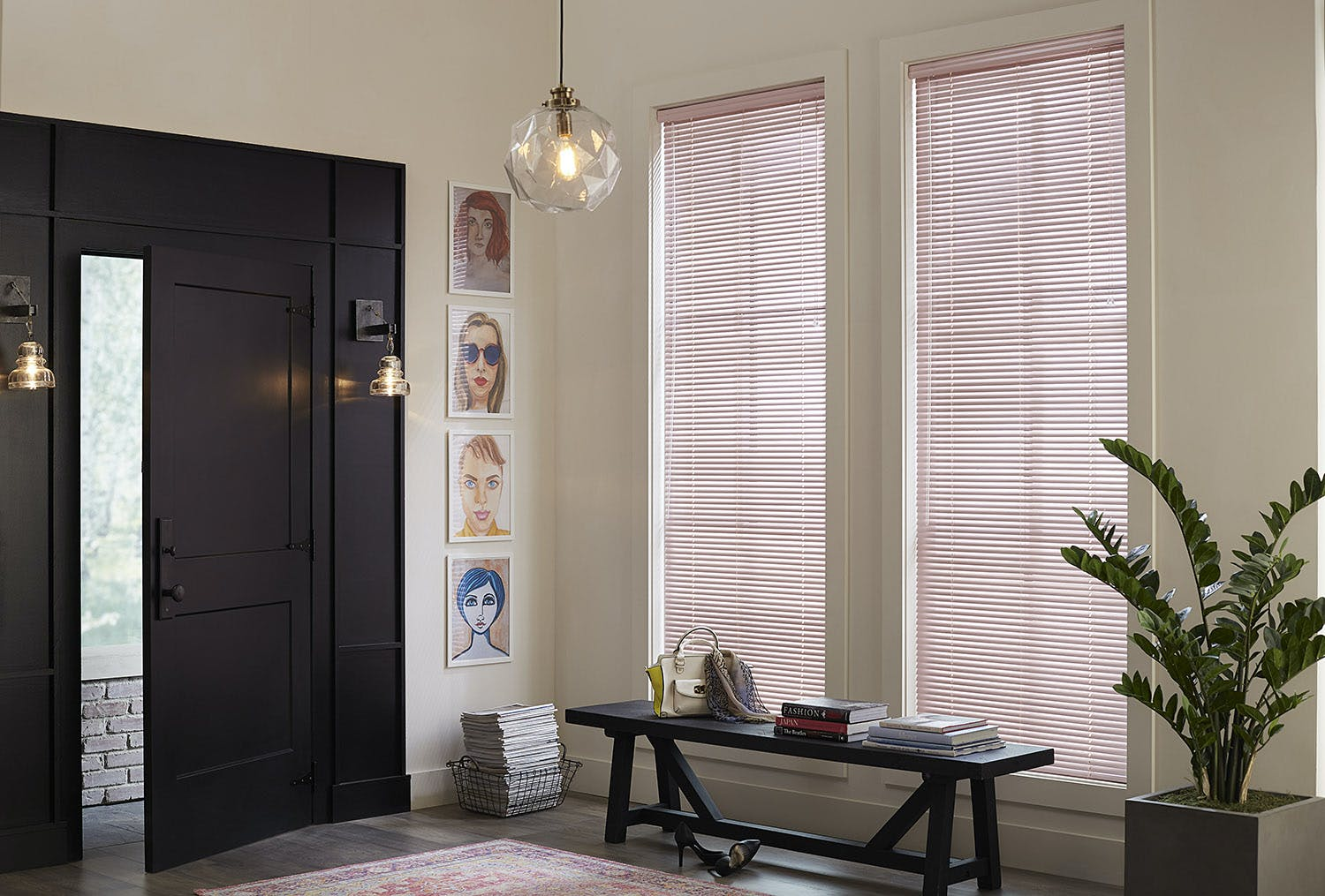 Pastel pink aluminum mini blinds in a modern entry way.