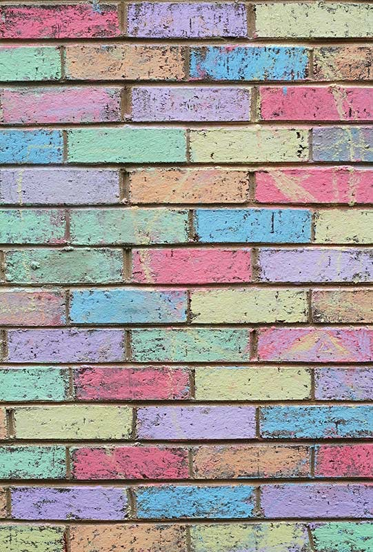 Brick wall colored in with sidewalk chalk.
