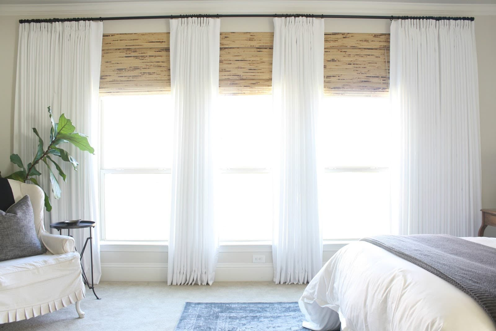 bedroom with bright natural light and bamboo blinds