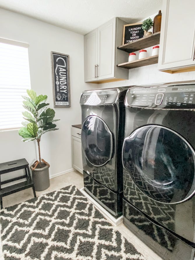 laundry room with front loading washers and chevron rug