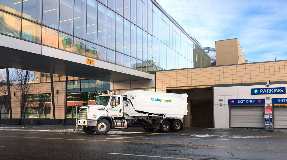 BluPlanet Recycling Truck Carrying Compactor Downtown Calgary