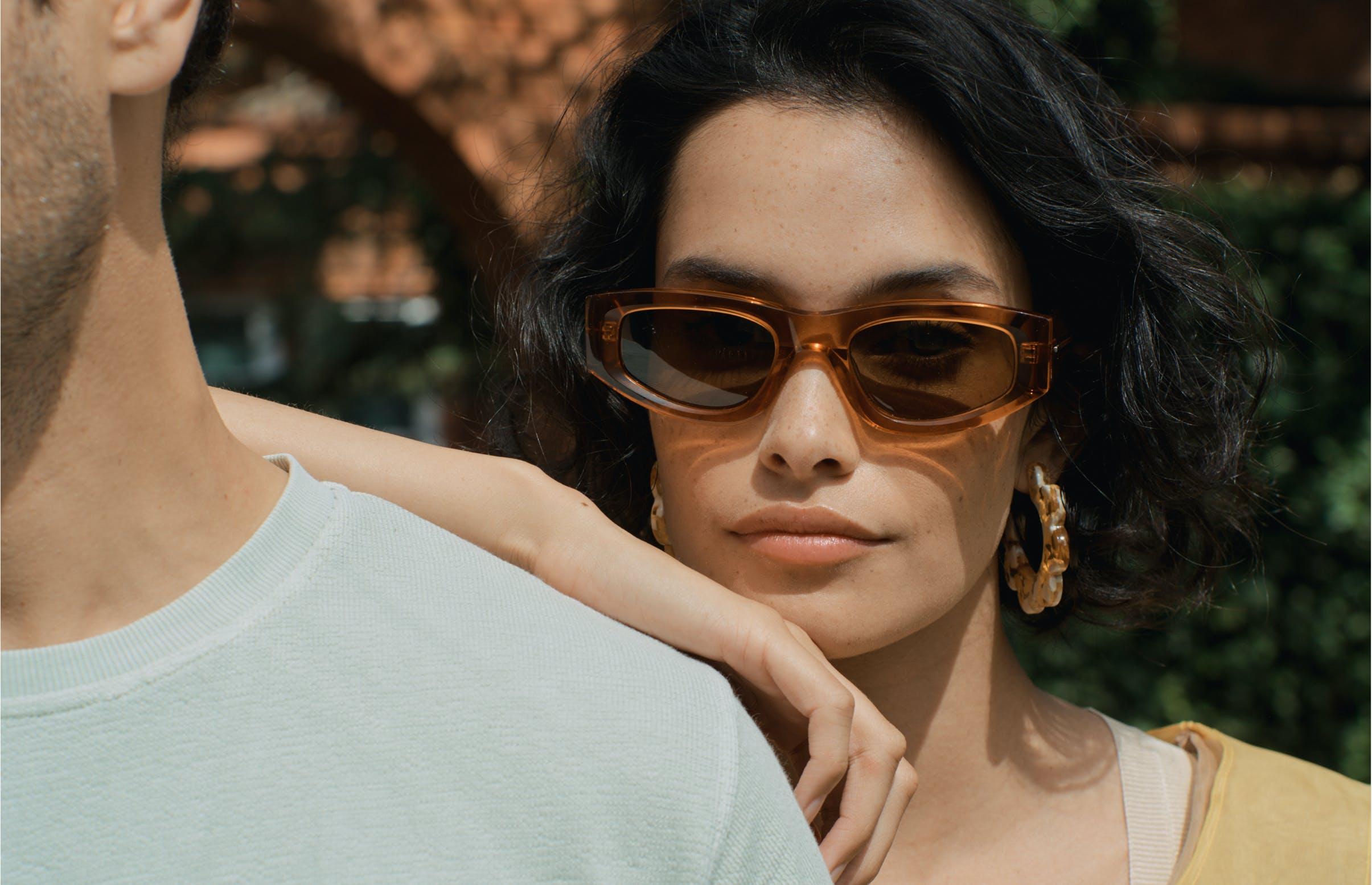 Woman leaning against man's shoulder wearing Gartner sunglasses