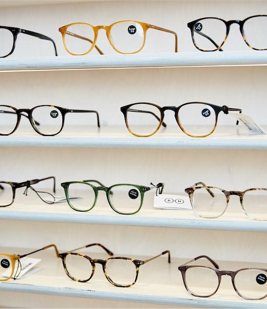 Glasses on shelf of store